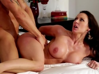 A milf that has a big ass is feeling a cock in her tight pussy