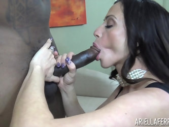 Busty girl Ariella Ferrera rides a big black cock while her tits bounce