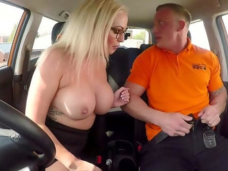 The man's energized dick fucks this hot MILf during her first driving lesson