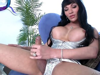Mia Isabella is the kind of chick with dick that could ride on a stiff boner all night long, but this time we get to see her handle her own big cock a