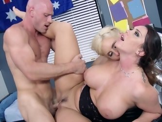 A blonde and a blonde are getting fucked hard by a large man