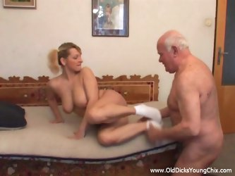 Busty blonde skank gets her mouth and cunt fucked by an old guy