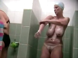 For me that sporty mature bitch with big saggy tits looks hot. Watch her taking shower after swimming pool. Her wide hips look delicious.
