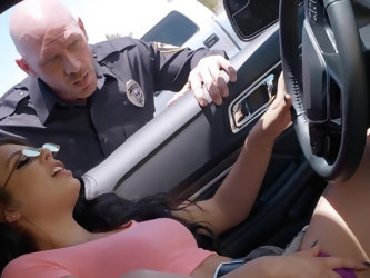 She's so lost in playing with her pussy that she doesn't notice the police officer standing by her window. She gets out of the masturbating