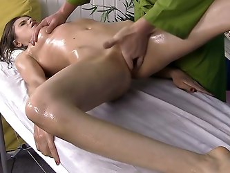 Alluring brunette beauty with slim body gets full body massage from a a masseur. then she gives head and getsher pink punani nailed in sideways and do