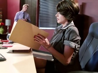 A brunette that has huge boobs is getting her pussy slammed in her office