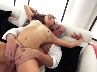 A curly long haired minx is feeling a grandpa inside her wet pussy