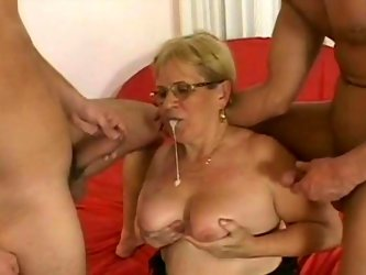 Light haired fat mommy with huge tits and in black stockings blows staff penis of one guy and gets her dumpy old cunt attacked from behind by another