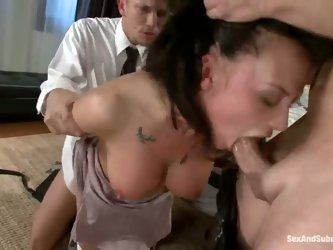 Mr. Pete and John Strong pay a surprise visit to Chanel Preston, cuffing her hands on her back and forcing her to deep throat both of them while fucki
