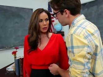 A busty bimbo milf teacher is fucking a nerd in the classroom