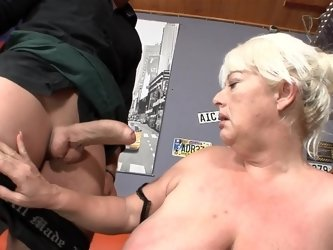 A fat granny is getting fucked hard in the bar in this video
