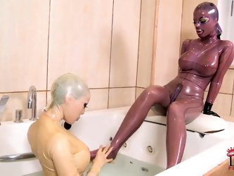 In the world of the delightfully perverse, some girls like to take a bath while theyre wearing latex bodysuits and masks. Thats what happens in our fe