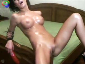 Girl with perfect body riding bed post