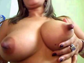 Horny chick plays with her big boobs spiced up with hard and perky nipples. Enjoy watching big juicy melons in kinky sex tube video for free.