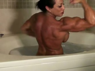This muscular bitch is in no hurry at all. She gets naked and takes a bath. Her well-shaped legs and big tits look absolutely great. I am gonna pay as