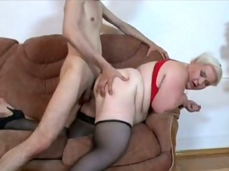 Fluffy light-haired skank wearing red lingerie and black stockings gets her ugly quim rammed doggystyle. Then she sucks juicy prick to get a facial cu