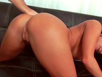 Striking busty brunette moans while her wet pussy is screwed hard
