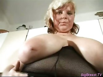 Voluptuous busty fucks with dildo