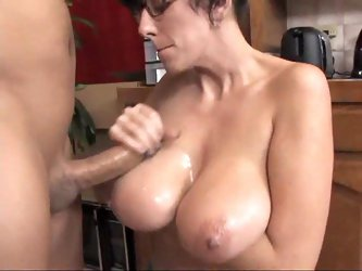 Nerdy babe in glasses gets tit fucked