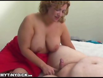 Fat girl makes fun of his tiny cock while blowing him