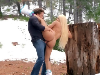 Snow surrounds them as wonderful blonde babe Luna Star and her man fuck outdoors. She's wearing only a pair of boots but the cold doesn't se