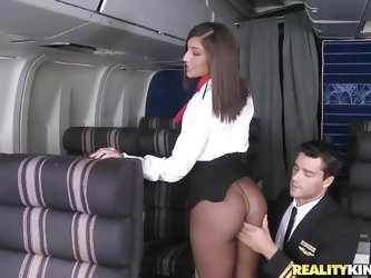 Ready for take-off captain! But before that, this curvy flight stewardess went down on her knees to give the pilot a blowjob! Joining the mile-high cl