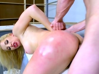 A blonde gets her ass spanked and she then gets fucked hard