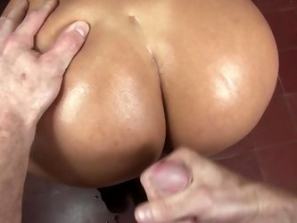 Milf with a big ass smiles as she is giving a sensual blow job