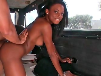 Inviting ebony doll gets shagged hard in a van