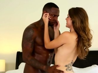 A black guy that has a big cock is fucking a hot brunette chick