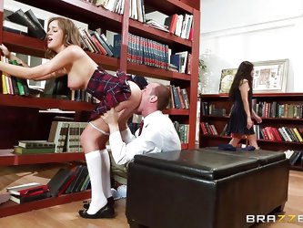 Let's hope this dirty slut won't disturb the librarian, while she is fucking her boyfriend in the stacks. The sexy schoolgirl has her clothe