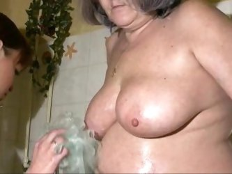 Plump grandma has her trichoid beaver washed by caretaker