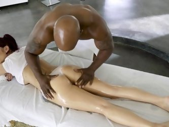 A redhead is getting massaged and she is also fucked