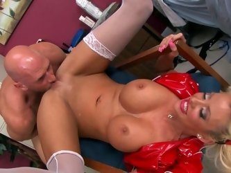 A busty blonde with a perfect set of tits is penetrated by a man
