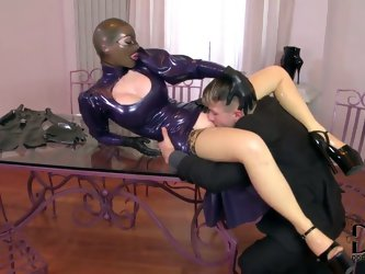 It is hard to read the expression on Latex Lucy's face, but it is still possible to know what she thinks by the way she breathes. The man, who fu