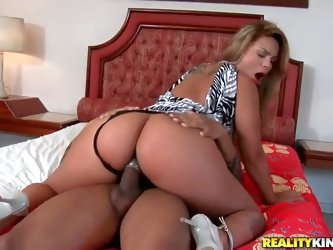 Watch as this Brazilian hottie rides and worships a gigantic black dick, and does it in a bed that'd fit in just fine in the honeymoon suite of a