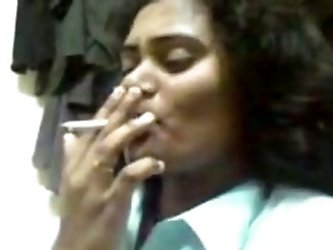 Nasty Indian hooker with ugly as fuck face features flashes her saggy tits. She then smokes a cigarette on camera. Kinky Indian porn video presented t