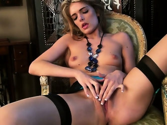 Lucy loves to whore it up and masturbate in her kinky stockings