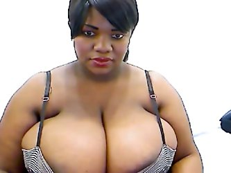 This playful ebony charmer with huge juicy melons is one of a kind. I love her tits. I love the sensual cleavage they create when they are pressed tog