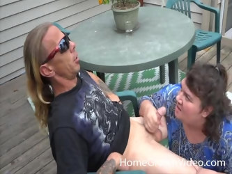 BBW mature sucks two large dicks in the back yard and loves it